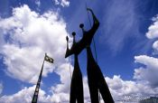 Travel photography:Os Candangos monument on the Praça dos Três Poderes (Square of the three powers) in Brasilia, by artist Bruno Gio, Brazil