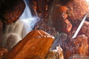 Small cave with gushing water from the Len��is river , Brazil