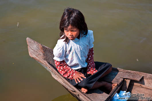 Small girl in boat near Tonle Sap lake