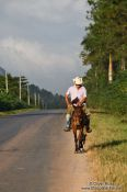 Travel photography:Man on horse in near Vi�ales, Cuba