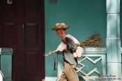Travel photography:Man with broom in Vi�ales, Cuba