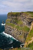 Travel photography:O'Brien's tower high above the Cliffs of Moher seen from the distance, Ireland