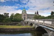 Travel photography:Bridge across the river Corrib in Galway with the cathedral in the background, Ireland