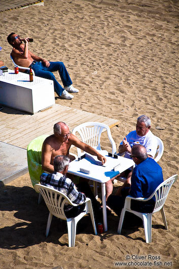 barcelona beach photos. Men at Barcelona beach