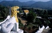 Travel photography:Guardian overlooking a valley near Chiang Rai, Thailand