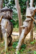 Travel photography:Wooden guardians at the entrance gate to the Ban Lorcha Akha village, Thailand