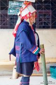 Travel photography:Woman in traditional dress at the Ban Lorcha Akha village, Thailand