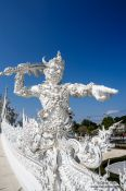 Travel photography:Guardian at the Chiang Rai Silver Temple, Thailand