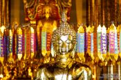 Travel photography:Golden Buddha inside Wat Chedi Luang Worawihan in Chiang Mai, Thailand
