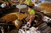 Travel photography:Woman making a parasol at the Bo Sang parasol factory, Thailand