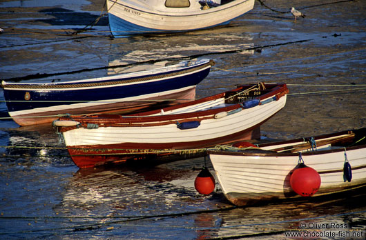 Small rowing boats in a Cornwall harbour at low tide