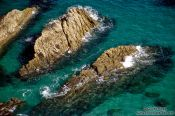 Travel photography:Rocks in the sea in Cornwall, United Kingdom