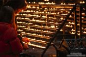 Travel photography:Lighting candles inside Stephansdom cathedral, Austria
