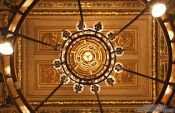 Travel photography:Ceiling and chandelier inside the Vienna State Opera, Austria