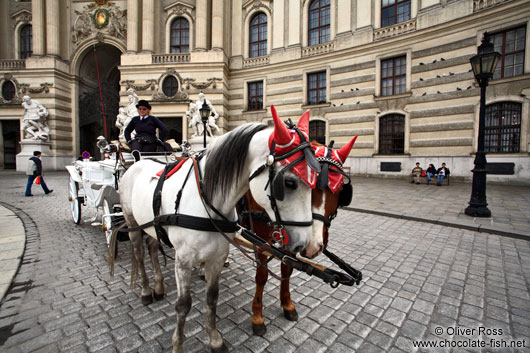 A Fiaker (horse cart for tourists) outside Vienna´s  Hofburg