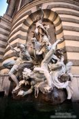 Travel photography:The Macht-zur-See fountain at the Michaeler square outside the Hofburg, Austria