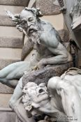 Travel photography:Detail of the Macht-zur-See fountain at the Michaeler square outside the Hofburg, Austria