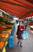 Travel photography:Vienna Naschmarkt shopper , Austria