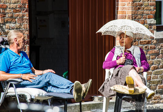 Local residents enjoy a summer day in Bruges
