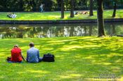 Travel photography:People enjoying summer in a Bruges park, Belgium