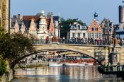Travel photography:Ghent bridge across canal with houses, Belgium