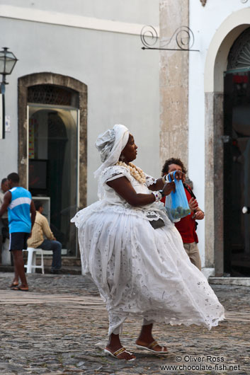 Woman wearing a typical Bahia dress in Salvador