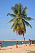 Travel photography:People on Boipeba Island beach, Brazil