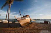 Travel photography:Boat on Praia do Forte beach at sunset, Brazil