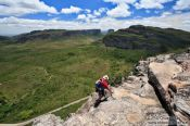 Travel photography:Climber arriving on top of the Morro do Pai Inácio, Brazil