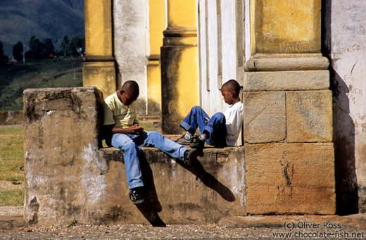 Two boys playing with their mobile phones, Ouro Preto