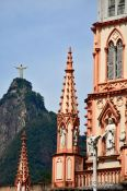 Travel photography:Facade detail of the Igreja da Imaculada Conceiçao in Botafogo with Corcovado, Brazil