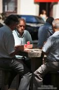 Travel photography:Men playing cards in a Rio park, Brazil