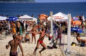 Travel photography:Playing futevôlei (footvolley) at Ipanema beach in Rio, Brazil