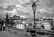 Travel photography:Houses along the Lesser Quarter with castle at the top, viewed from Charles bridge, Czech Republic