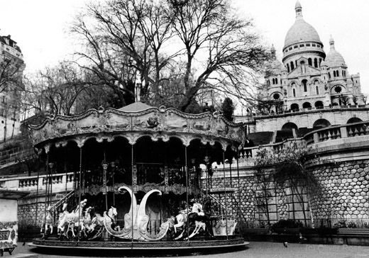 Paris Sacre Coeur basilica with carousel on Montmartre