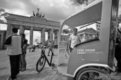 Travel photography:The Brandenburg Gate in Berlin with cycle rickshaw, Germany