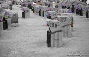 Travel photography:Tinted black and white image of beach baskets in Laboe, Germany