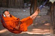 Travel photography:Buddhist monk with headphones near Angkor Thom, Cambodia