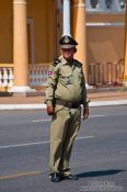 Travel photography:Traffic police outside the Phnom Penh Royal Palace , Cambodia