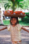 Travel photography:Little girl selling food outside Wat Phnom in Phnom Penh, Cambodia