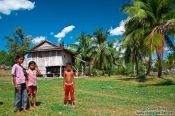 Travel photography:Children outside their home between Sihanoukville and Kampott , Cambodia