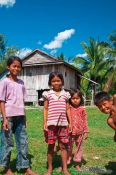 Travel photography:Kids outside their home between Sihanoukville and Kampott , Cambodia