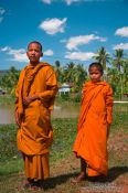 Travel photography:Two buddhist monk novices along the road between Sihanoukville and Kampott , Cambodia