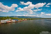 Travel photography:Houses along a river between Sihanoukville and Kampott , Cambodia