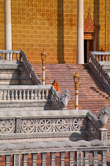 Monk descending a temple staircase at the Vipassara Dhara Buddhist Centre near Odonk (Udong)