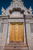 Travel photography:Golden door at the large stupa on a hill above the Vipassara Dhara Buddhist Centre near Odonk (Udong), Cambodia