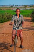 Travel photography:Man on bike near Odonk (Udong), Cambodia