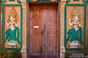 Travel photography:Wooden door at a temple near Odonk (Udong) , Cambodia