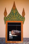 Travel photography:Temple window with large drumm near Odonk (Udong) , Cambodia