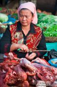 Travel photography:Meat vendor at the Battambang central market , Cambodia